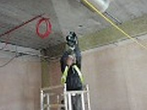Wearing Eye Protection & Dust Mask When Drilling